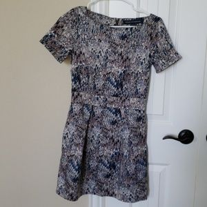 dress with a boat neck and pockets